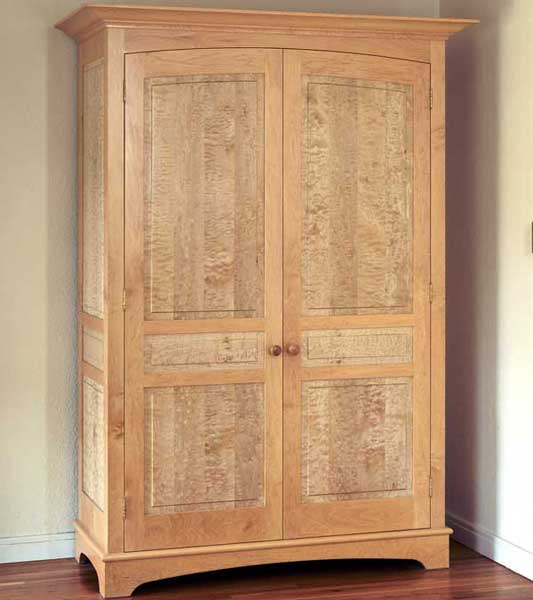 Hard Maple and bleached quilted maple armoire.