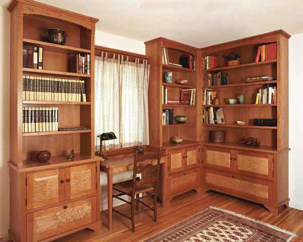 Study bookcases and writing desk, cherry and quilted maple.